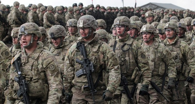 Soldiers of the 2nd Armored Cavalry Regiment of the U.S. Army during the welcome ceremony of the NATO Enhanced Forward Presence (eFP) contingent in the Military Training Center of the Land Forces in Orzysz, north Poland, April 13, 2017. (EPA Photo)