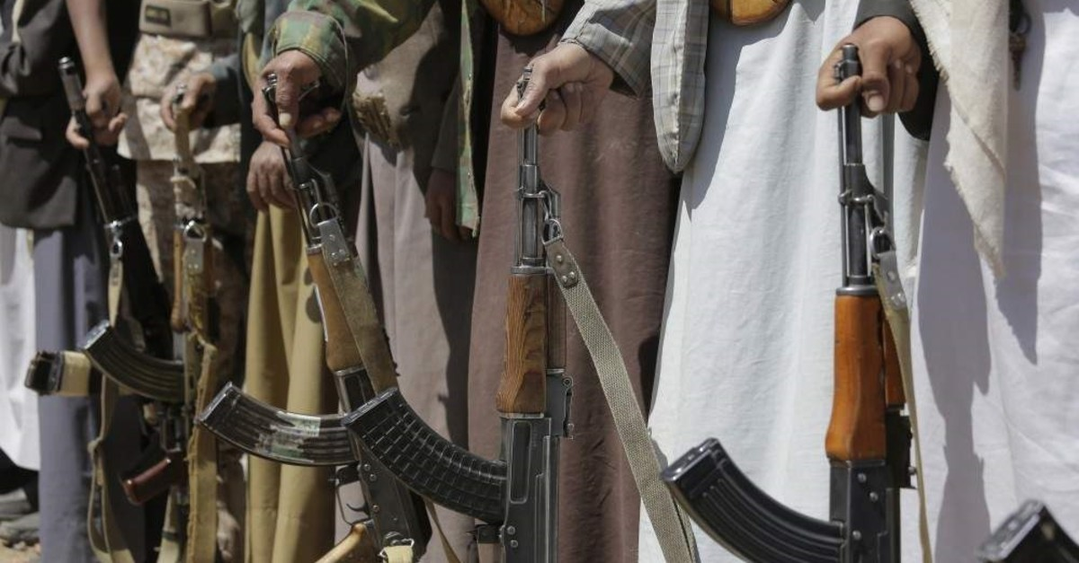 In this file photo dated Sept. 21, 2019, Shiite Houthi tribesmen hold their weapons during a tribal gathering showing support for the Houthi movement, in Sanaa, Yemen. (AP Photo)