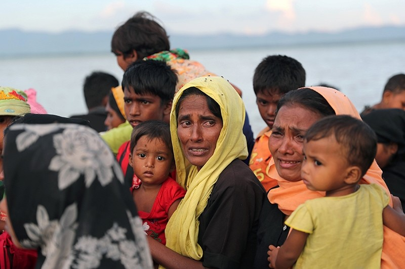 Rohingya refugee women cry while crossing the Naf River with an improvised raft to reach to Bangladesh, Teknaf, Bangladesh, Nov. 12, 2017. (Reuters Photo)