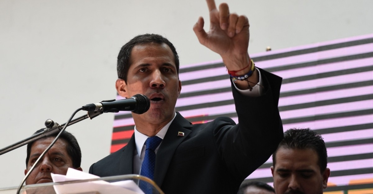 Venezuelan opposition leader and self-proclaimed interim president Juan Guaido gestures as he speaks giving details of what he calls ,Operation Freedom, during a rally with local and regional leaders, in Caracas on March 27, 2019. (AFP Photo)