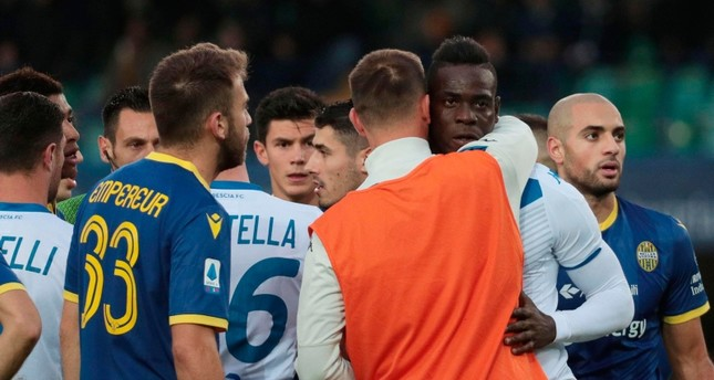 Brescia's Mario Balotelli, second from right, reacts to Verona supporters' racist chants during the Italian Serie A soccer match between Verona and Brescia at the Bentegodi stadium in Verona, Italy, Sunday, Nov. 3, 2019. (Simone Venezia/ANSA via AP)