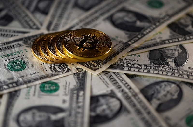 Bitcoin (virtual currency) coins placed on Dollar banknotes are seen in this illustration picture, Nov.  6, 2017 (Reuters Photo)