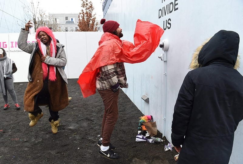 This file photo taken on January 24, 2017 shows US actor Shia LaBeouf(C) as he speaks in front of a camera during his u201cHe Will Not Divide Usu201d livestream outside the Museum of the Moving Image in Astoria, in the Queens borough of New York. (AFP Photo)