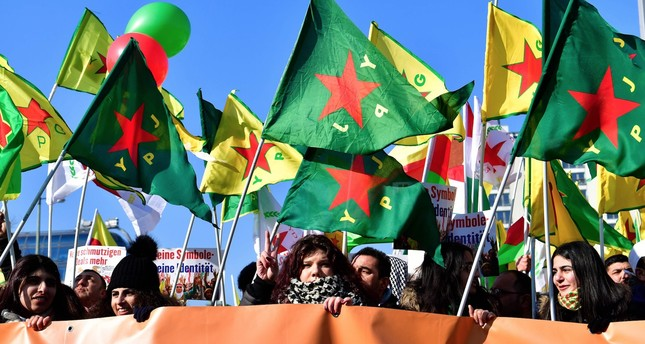 Protersters hold flags of the PKK's Syrian affiliate, the People's Protection Units (YPG), and of its female branch, the Women's Protection Units (YPJ), during a demonstration in Berlin, Germany, on March 3.