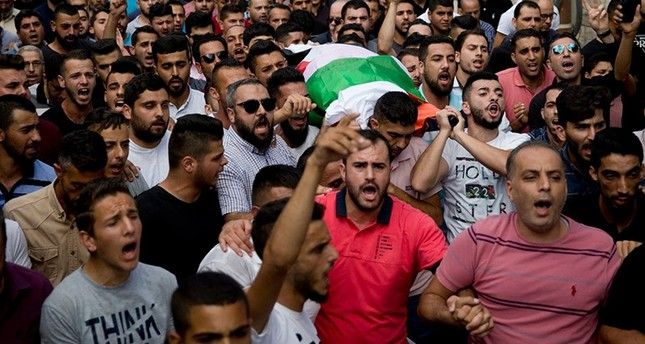 Palestinians carry the body of Aisha Mohammed Rabi during her funeral in the West Bank village of Biddya on Oct. 13. (Majdi Mohammed/AP)
