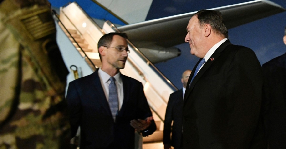 In this May 7, 2019 photo, Secretary of State Mike Pompeo, center, talks with Charge D'affaires at the US Embassy in Baghdad Joey Hood, left, after he arrived in Baghdad, for meetings. (AP Photo)