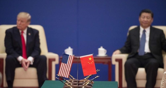 U.S. President Donald Trump L and China's President Xi Jinping attend a business leaders event in Beijing, Nov. 9, 2017. AFP Photo