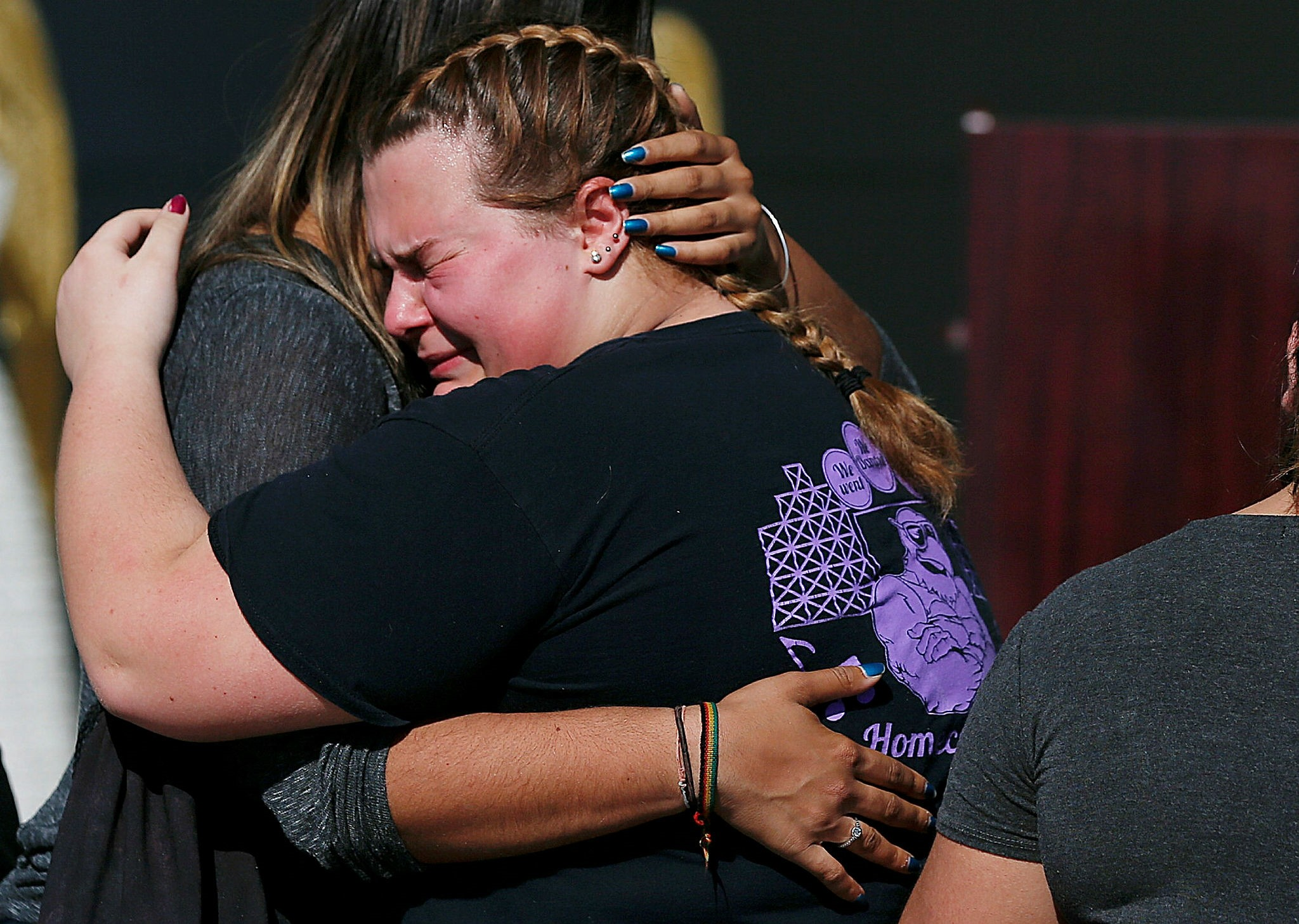 Kieran Ahearn, right, cries on the shoulder of her friend, Lara Bortolotti, left, during a community vigil at Pine Trails Park, Thursday, Feb. 15, 2018, in Parkland, for the victims of the shooting at Marjory Stoneman Douglas High School. (AP Photo)