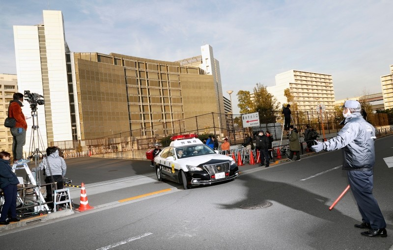 A police car drives away from Tokyo Detention Center, where former Nissan chairman Carlos Ghosn and another former executive Greg Kelly, are being detained, in Tokyo Tuesday, Dec. 25, 2018 (AP Photo)