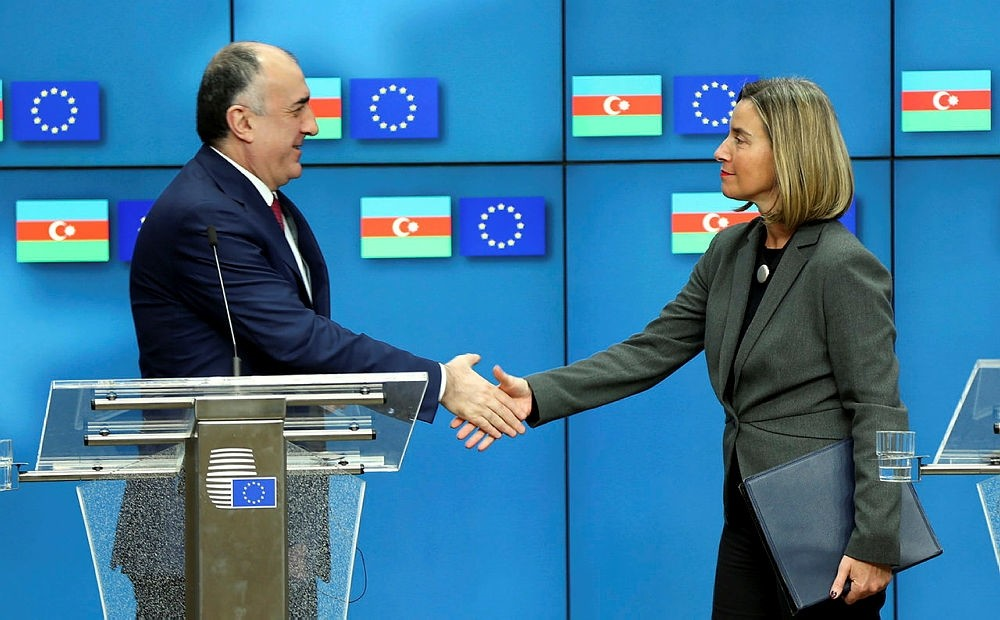 High Representative of the European Union for Foreign Affairs and Security Policy Federica Mogherini, right, shakes hands with Azerbaijani Foreign Minister Elmar Memmedyarov during joint news conference in Brussels, Belgium, Feb. 9, 2018. (AA Photo)