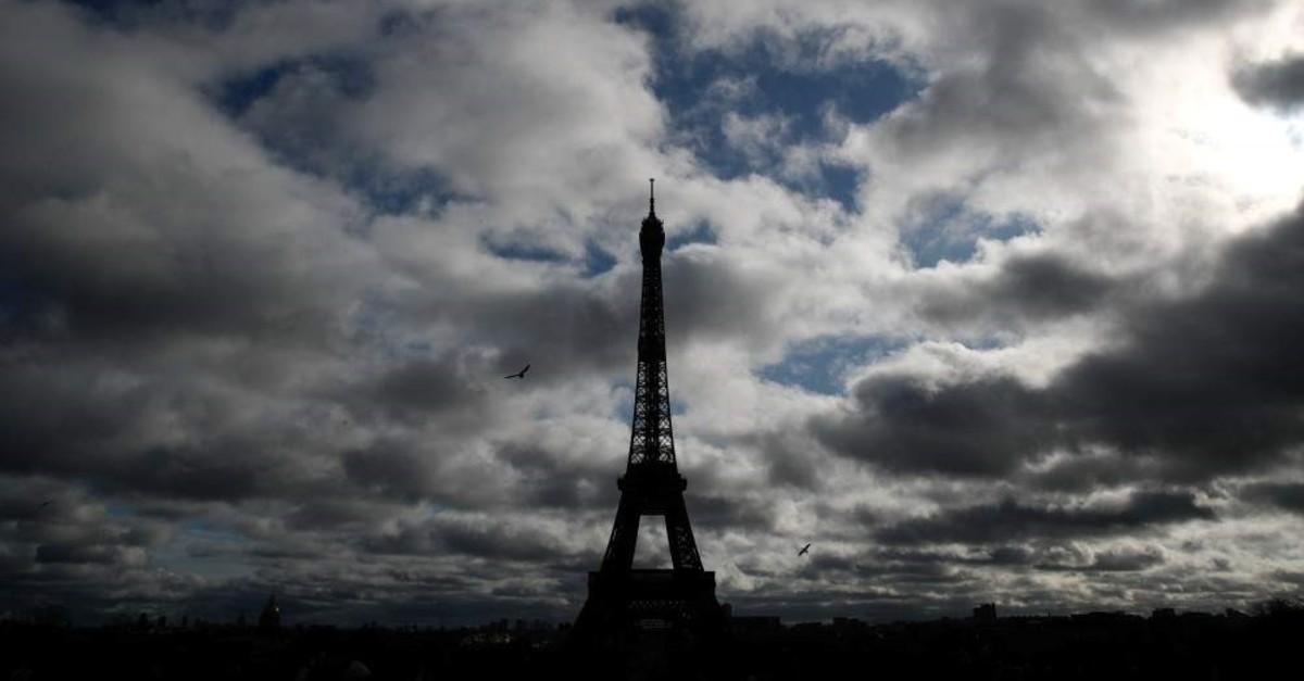 The Eiffel Tower silhouette is cast on a cloudy sky, Paris, Feb. 1, 2020. (REUTERS Photo)
