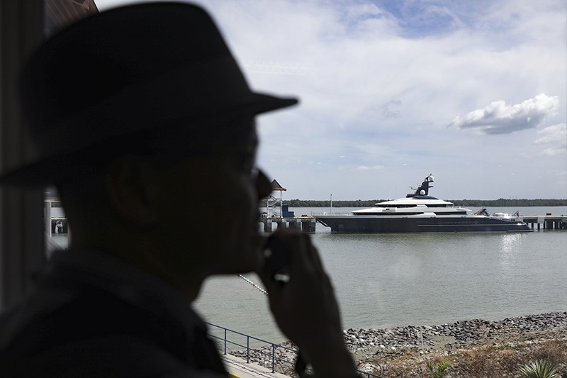 A man looks on the seized luxury yacht Equanimity, docked at Port Klang, Selangor, Malaysia, Aug. 11, 2018. (EPA Photo)