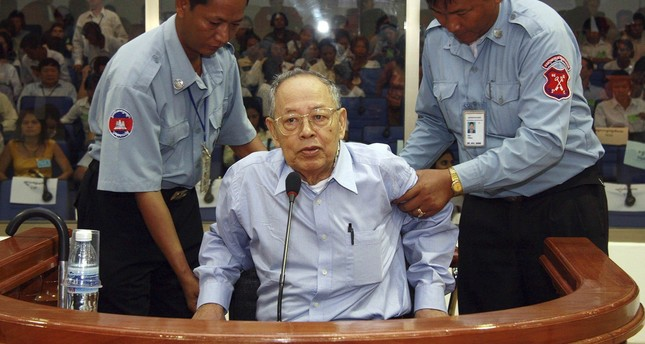 Former Khmer Rouge foreign minister Ieng Sary is assisted during his pre-trial hearing at the Extraordinary Chambers in the Courts of Cambodia (ECCC) in the outskirts of Phnom Penh in this June 30, 2008 file photo. (Reuters Photo)