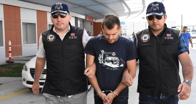 Police in Eskişehir escort Abdülkadir Ö., an officer accused of aiding would-be assassins of President Recep Tayyip Erdoğan during FETÖ's coup attempt, Sept. 10, 2019.