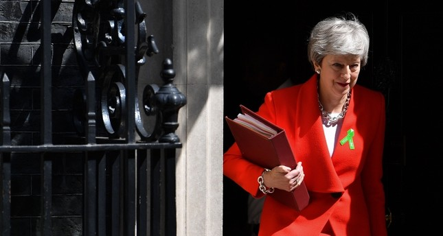 Britain's Prime Minister Theresa May leaves 10 Downing Street in London on May 15, 2019, ahead of the weekly Prime Minister's Questions PMQs question and answer session in the House of Commons.