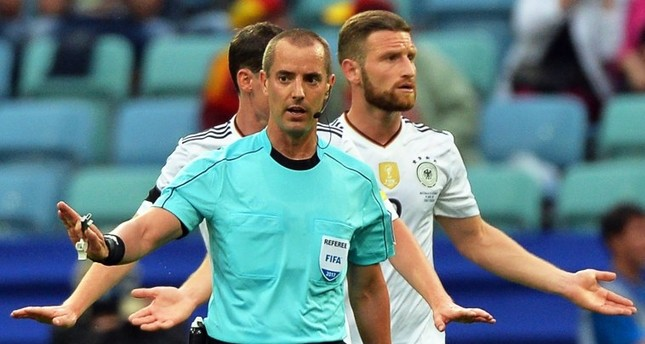 Referee Mark Geiger of the U.S. waits for a video assistant referee (VAR) decision during the FIFA Confederations Cup 2017 group B match between Australia and Germany.