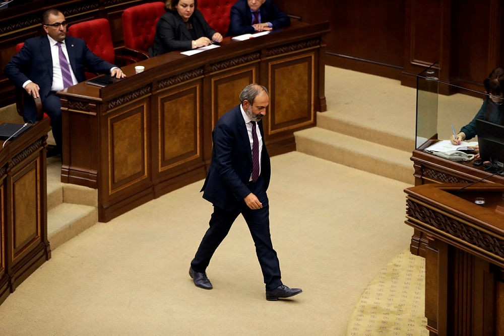 Opposition lawmaker Nikol Pashinian, center, during a parliament session to choose a replacement of Prime Minister in Yerevan on Tuesday, May 1, 2018. (AP Photo)