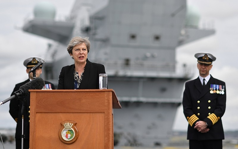 UK's Prime Minister Theresa May stands on the flight deck as she speaks to crew members of British aircraft carrier HMS Queen Elizabeth after it arrived at Portsmouth Naval base, its new home port, in Portsmouth, UK, August 16, 2017. (Reuters Photo)