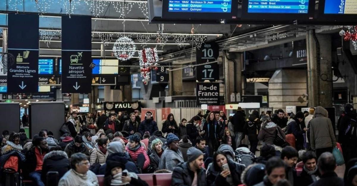 Commuters wait or walk at Gare Montparnasse train station, Paris, Jan. 2, 2020. (AFP Photo)