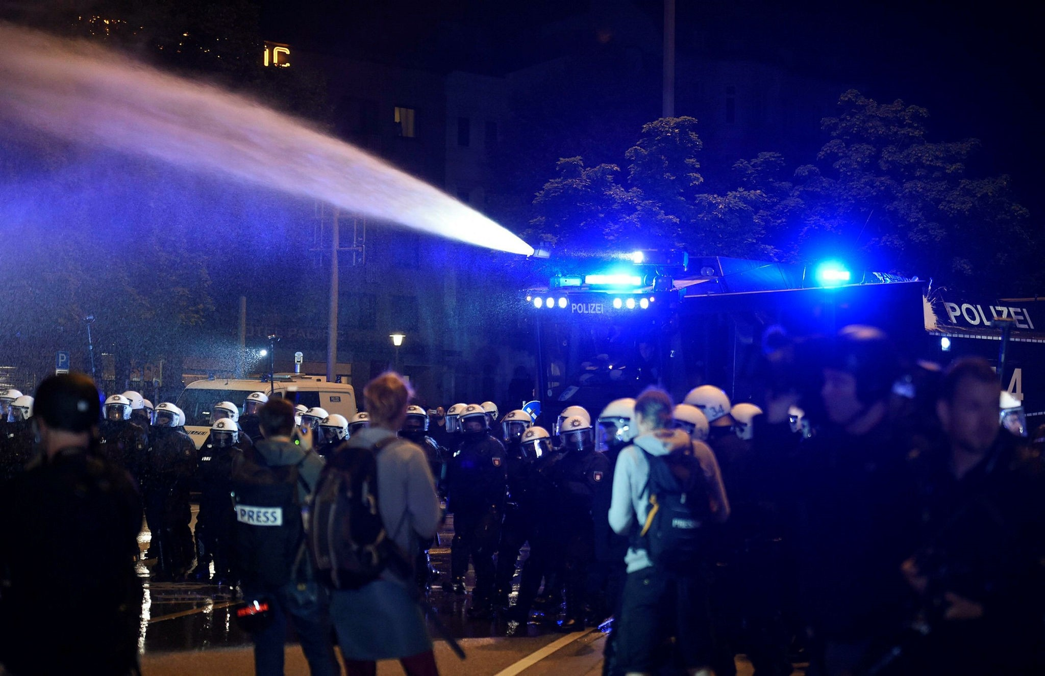 German riot police use a water cannon during a protest ahead the G20 summit in Hamburg, Germany, July 4, 2017. (Reuters Photo)