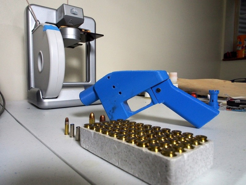 In this file photo taken on July 17, 2013 a Liberator pistol appears  next to the 3D printer on which its components were made in Hanover, Maryland. (AFP Photo)