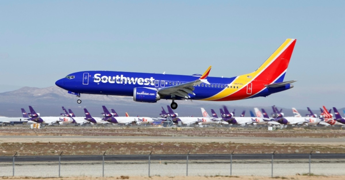 In this Saturday, March 23, 2019, photo, a Southwest Airlines Boeing 737 Max aircraft lands at the Southern California Logistics Airport in the high desert town of Victorville, Calif. (AP Photo)