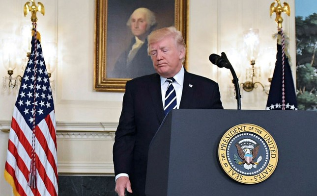 President Donald Trump talks from the Diplomatic Reception Room of the White House in Washington, Oct. 2.