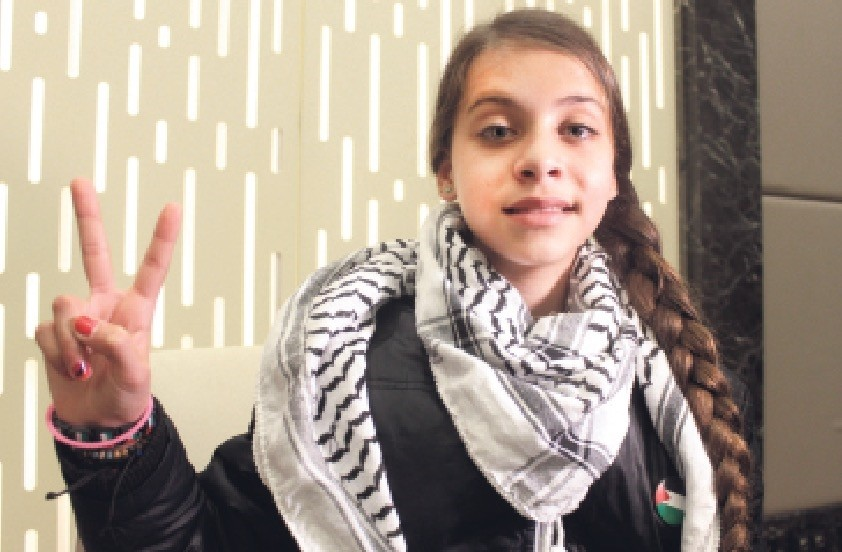 Ten-year-old Palestinian journalist Janna Jihad makes a peace sign during an interview following the International Benevolence Awards ceremony in Istanbul.