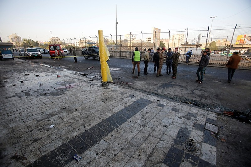 Iraqi security forces inspect the site of a bomb attack in Baghdad, Iraq Jan. 15, 2018 (Reuters Photo)