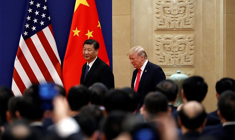 U.S. President Donald Trump and China's President Xi Jinping meet business leaders at the Great Hall of the People in Beijing, China, November 9, 2017 (Reuters Phtoo)