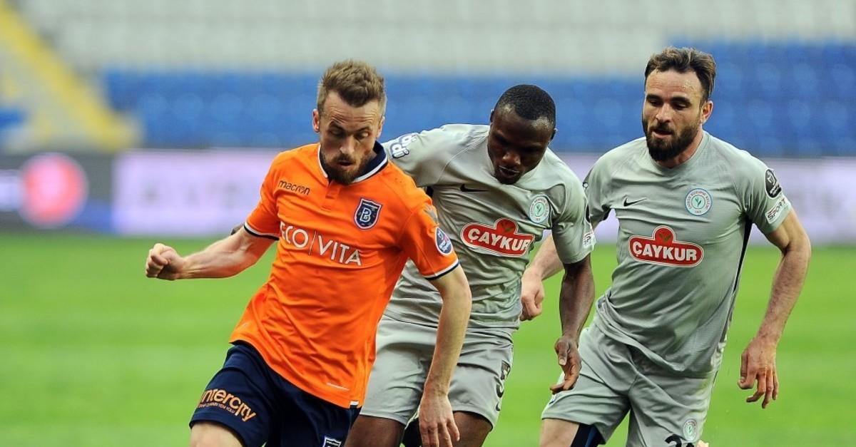 Edin Visca of Bau015faku015fehir chased by Rizespor players in Su00fcper Lig game, April 21, 2019.