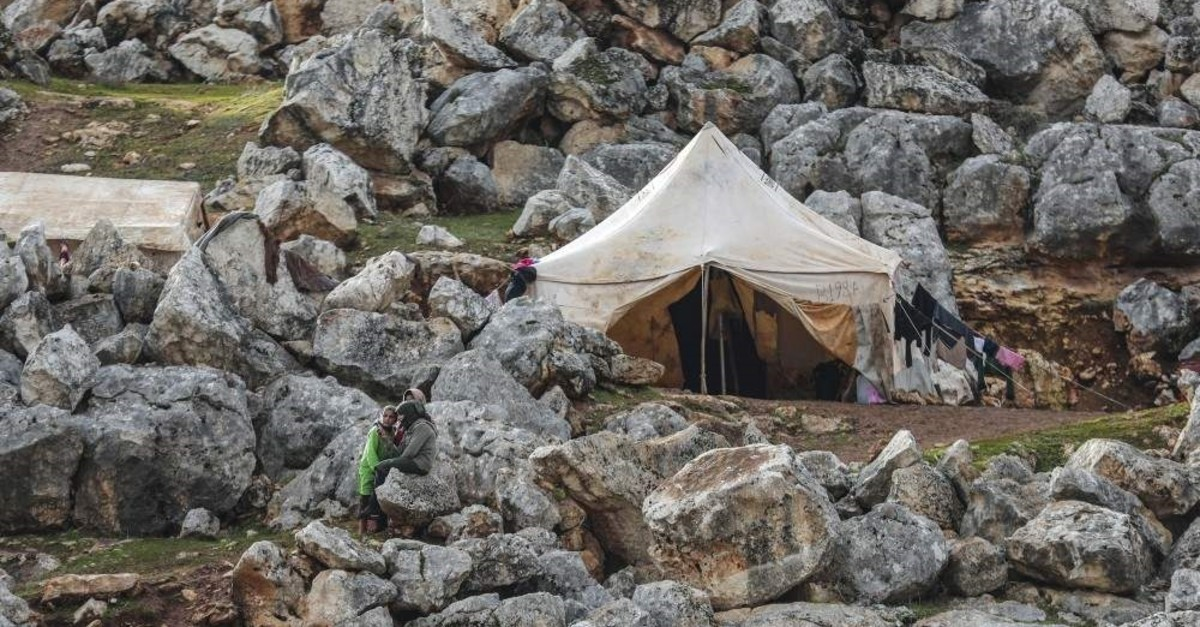 Families fleeing the attacks of the Assad regime and Syria are living in mud camps under harsh winter conditions in the Yavru Fida camp in rural ?dlib ( Esra Hacio?lu - Anadolu Ajans? )