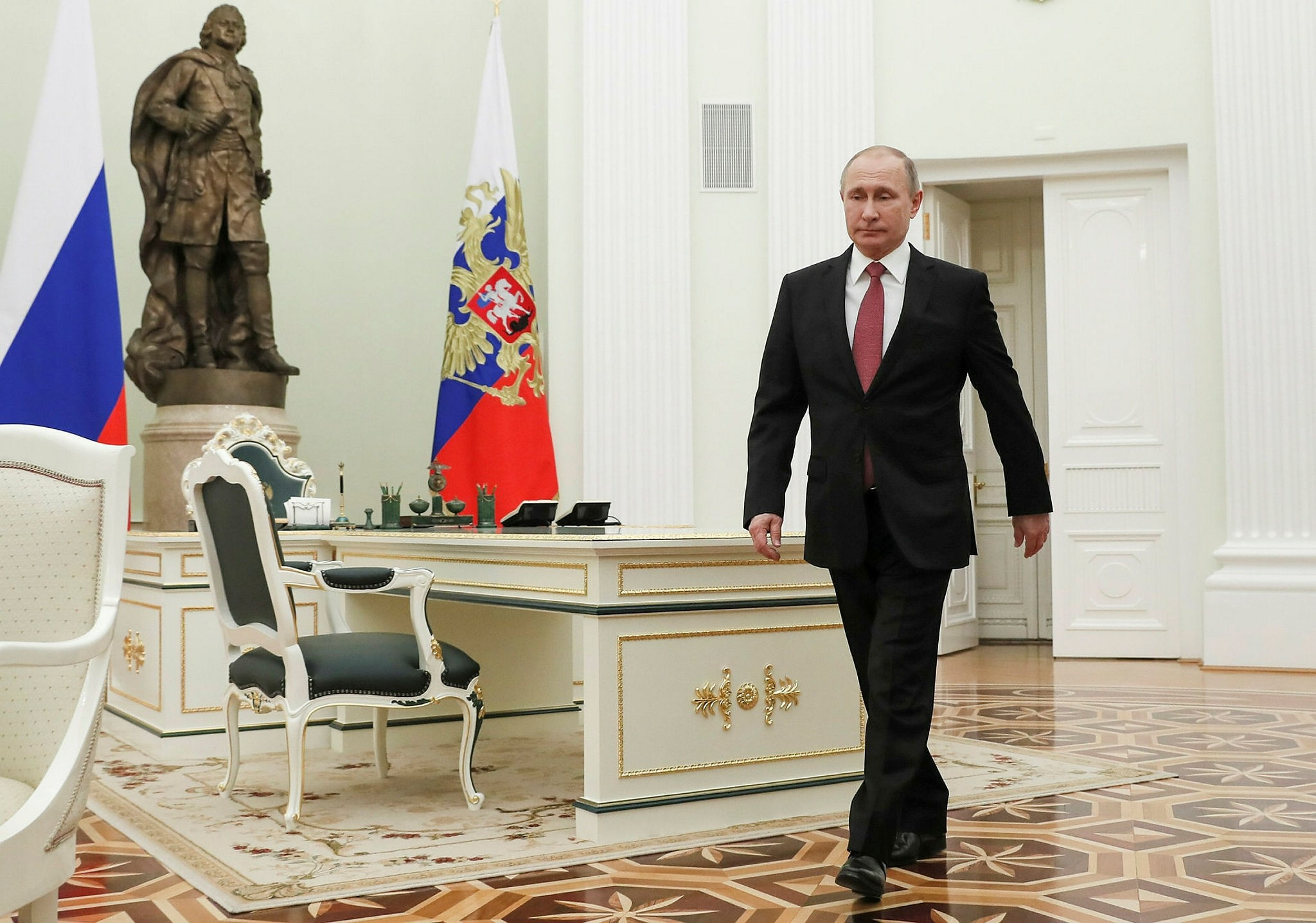 Russian President Vladimir Putin enters a hall to meet his Serbian counterpart Aleksandar Vucic during prior to their talks in the Kremlin in Moscow, Russia, Tuesday, Dec. 19, 2017. (AP Photo)