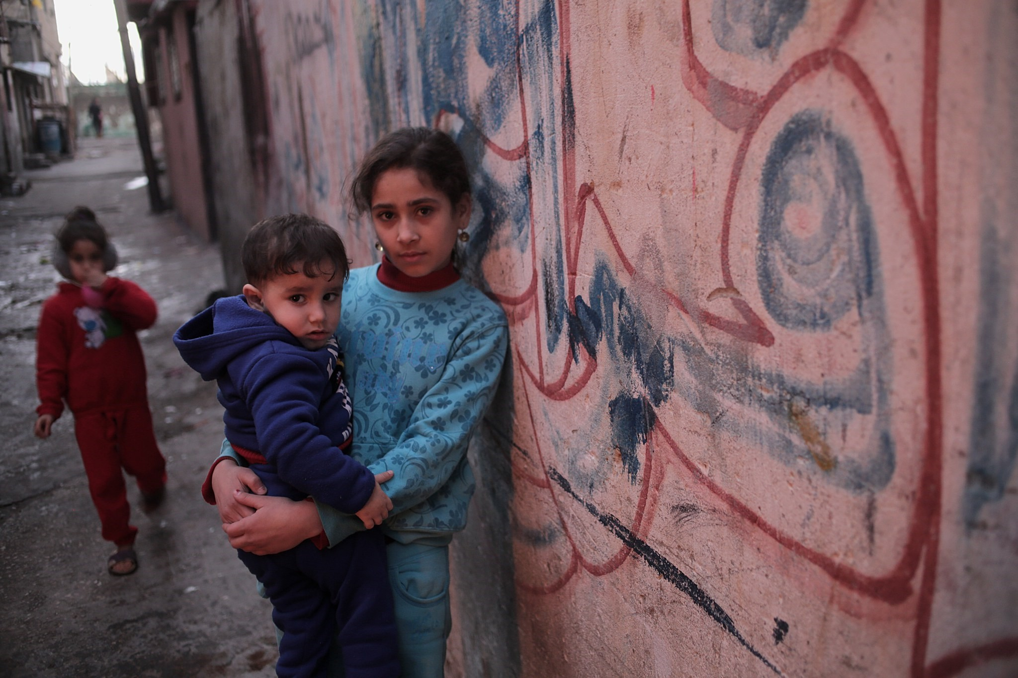 Palestinian refugees children play in the streets of al Shateaa refugee camp west northern Gaza City on January 17, 2018. (EPA Photo)