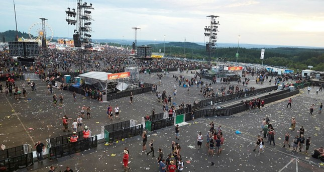 Visitors leave the music festival Rock am Ring outside the western town of Nuerburg, Germany, Friday, June 2, 2017. (Dpa via AP)