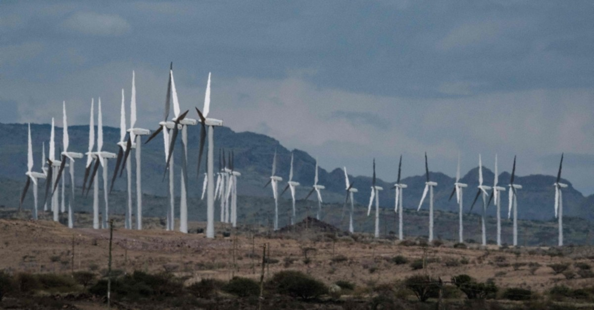 In this file photo taken on June 29, 2018 wind turbines of the Lake Turkana Wind Power project (LTWP) are seen in Loiyangalani district, Marsabit County, northern Kenya. (AFP Photo)