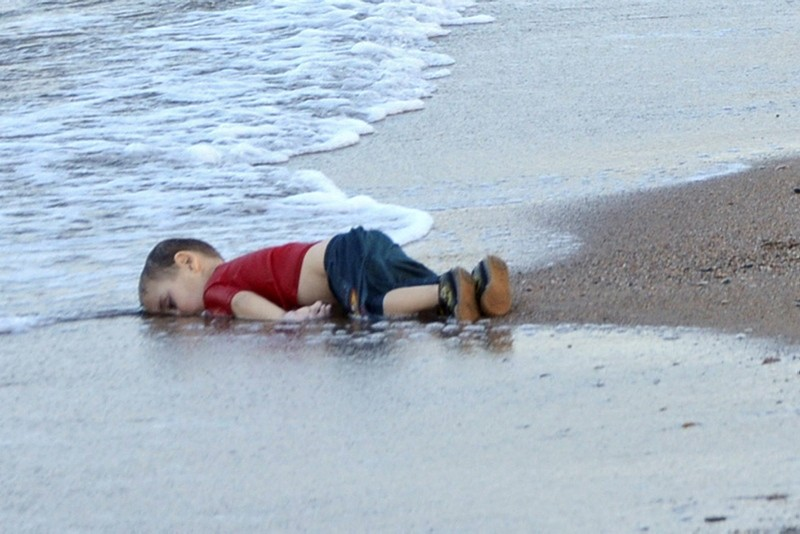 The washed up body of Aylan Kurdi, a refugee child who drowned during a failed attempt to sail to the Greek island of Kos, at the shore in the coastal town of Bodrum, Turkey. (EPA Photo)