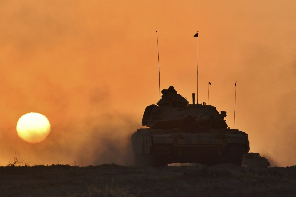 A Turkish army tank advances in Silopi near the Habur border gate with Iraq during a military exercise in southeastern Turkey on Sept. 29.
