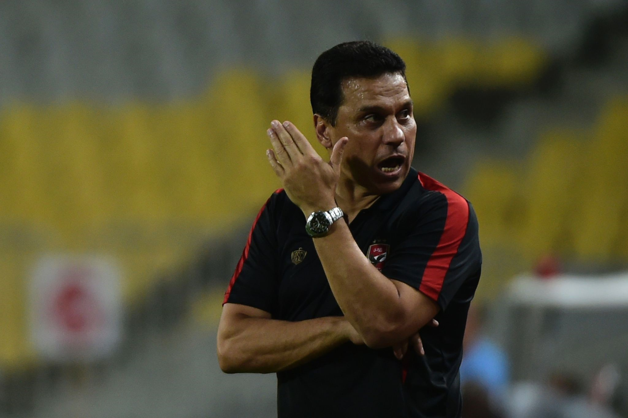 Egypt's Al Ahly coach Hossam el-Badry reacts during their African Champions League (CAF) group stage football match with Cameroon's Cotonsport. (AFP PHOTO)