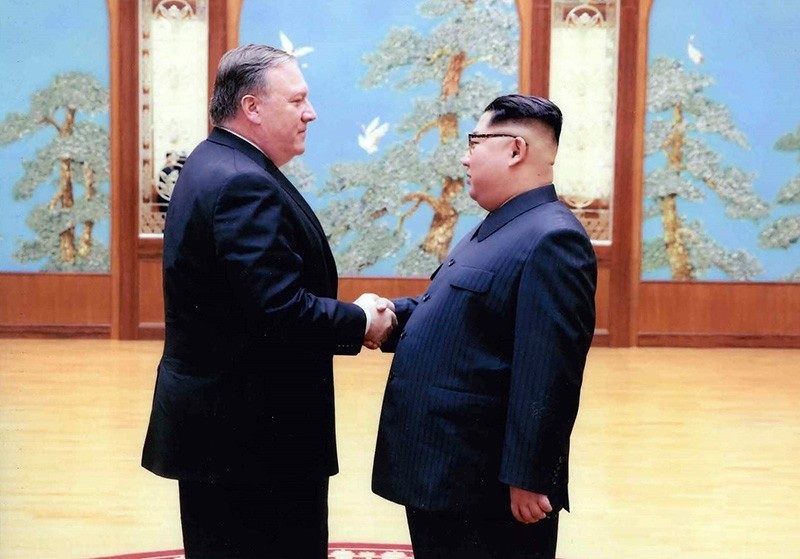 In this file photo released by the US Government on April 26, 2018, North Korean leader Kim Jong-Un (R) shakes hands with the former CIA Director, now US Secretary of State, Mike Pompeo (AFP Photo)