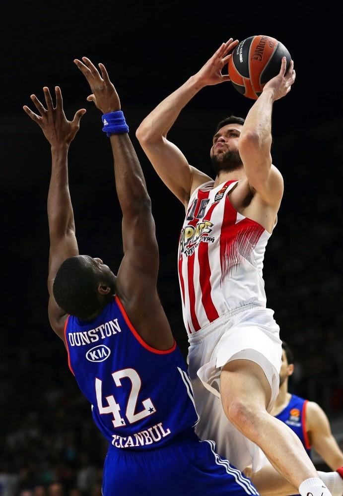 Olympiacosu2019 Kostas Papanikolaou (R) in action against Anadolu Efesu2019 Bryant Dunston (L) during the Euroleague Playoff round 3 basketball match in Istanbul.