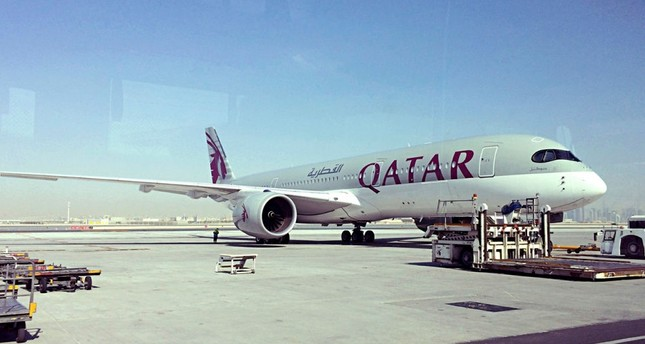 Photo shows a parked Qatari plane in Hamad International Airport in Doha, Qatar. (AP PHOTO)
