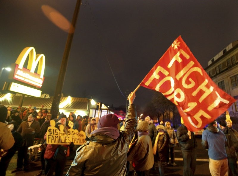 In this Nov. 29, 2016 file photo, protesters gather outside a McDonald's restaurant in Minneapolis during a demonstration for higher wages as part of the National Day of Action to Fight for $15. (AP Photo)