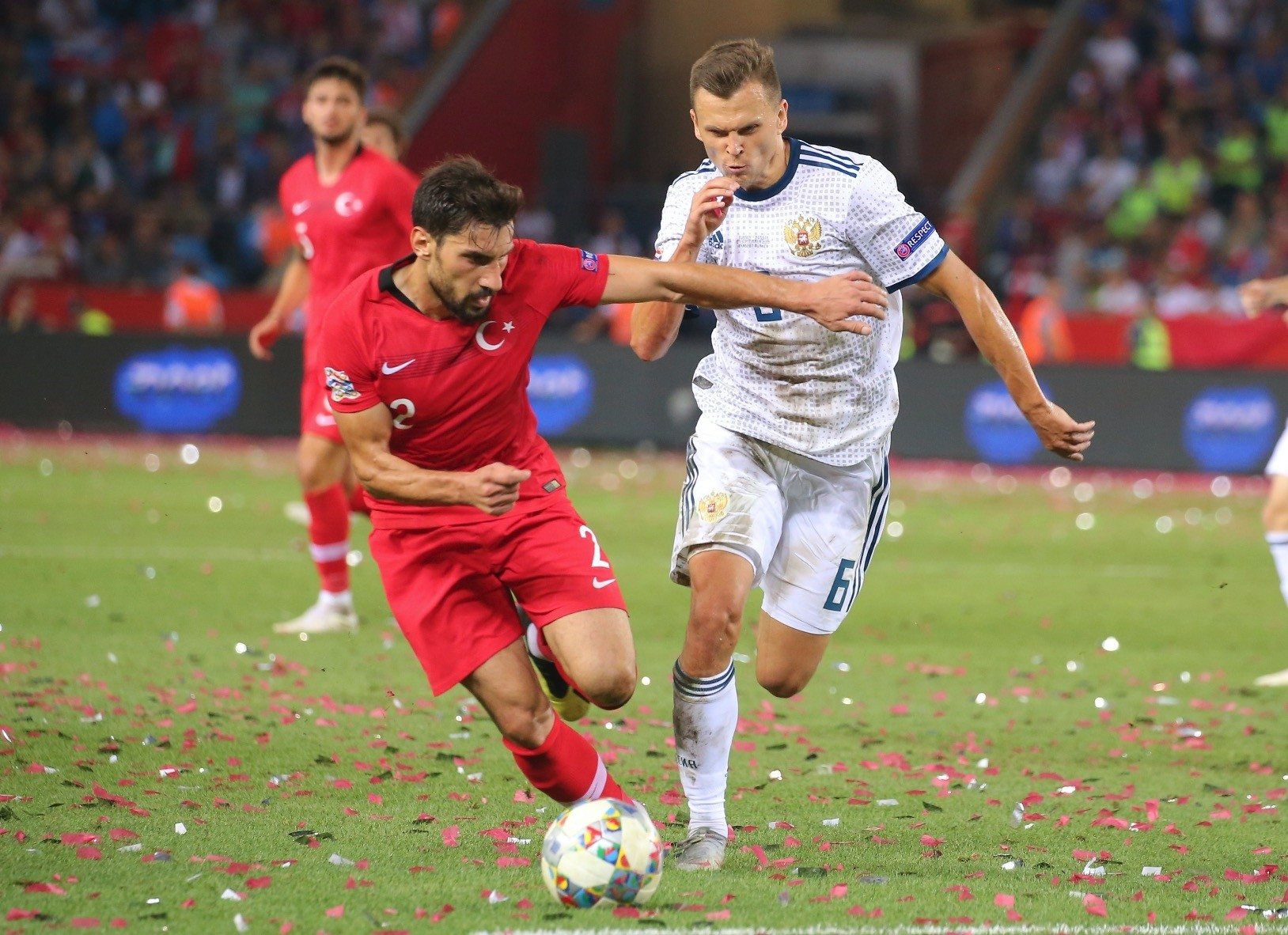 u015eener u00d6zbayraklu0131 (L) tries to dribble past Russiau2019s Denis Cheryshev during the UEFA Nations League match in Trabzon, Turkey, Sept. 7.