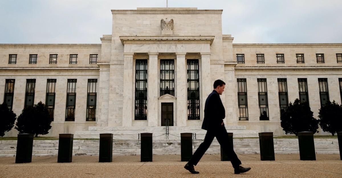 A man walks past the Federal Reserve Bank in Washington, D.C., Dec. 16, 2015.