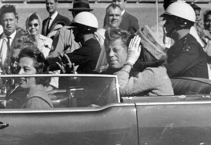 In this Nov. 22, 1963 file photo, President John F. Kennedy waves from his car in a motorcade in Dallas. (AP Photo)