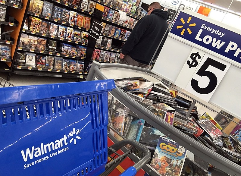 In this June 5, 2017, file photo, a shopper looks at merchandise at a Walmart in Salem, N.H. Wal-Mart Stores, Inc. reports earnings,, Aug. 17, 2017. (AP Photo)