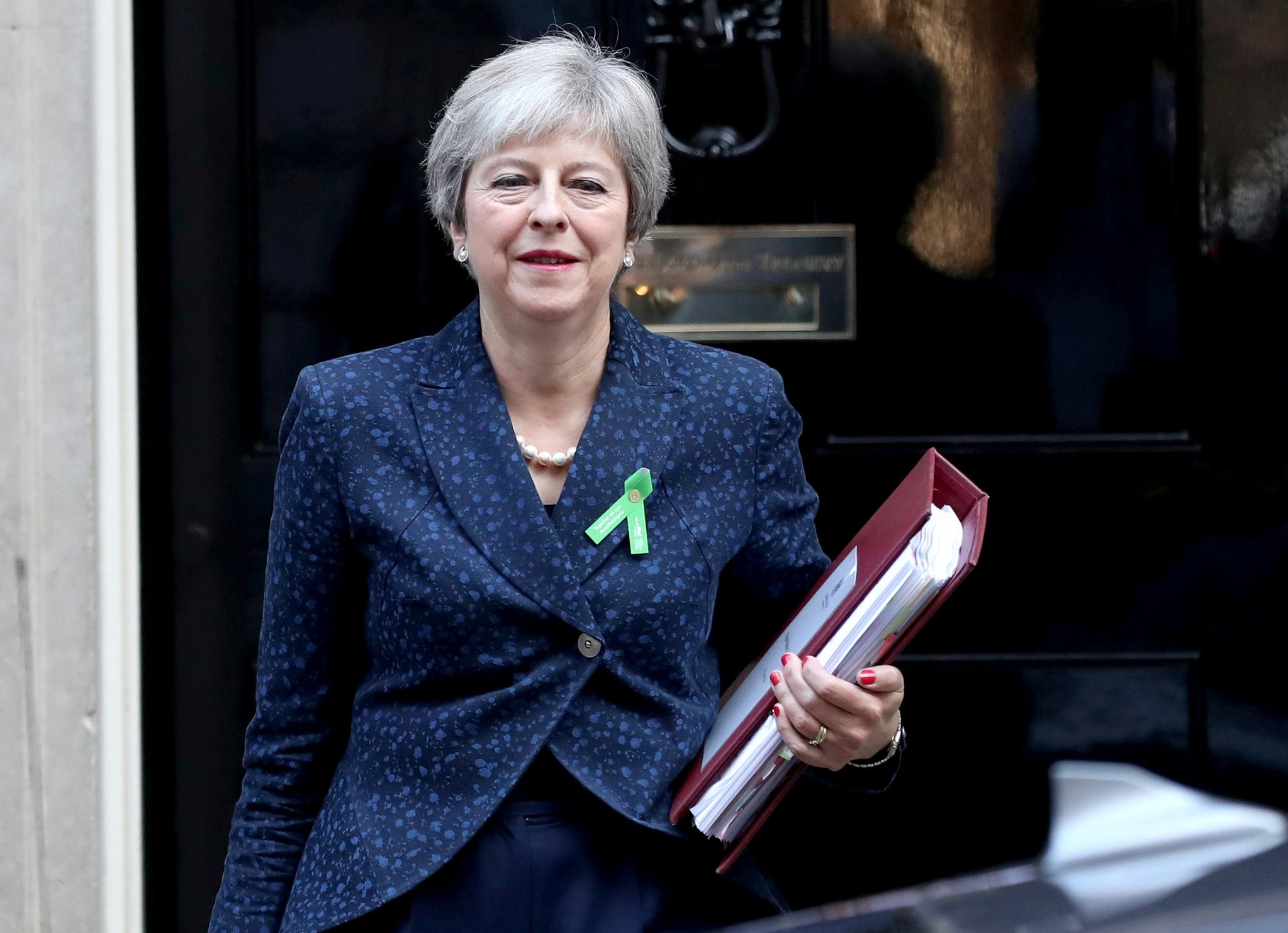 Britainu2019s Prime Minister Theresa May leaves Downing Street, London, Oct. 10.