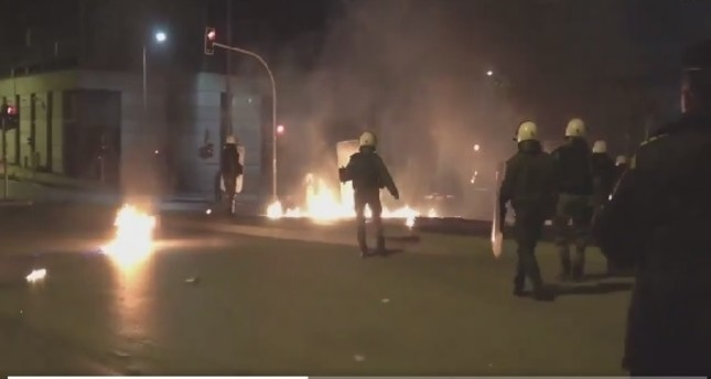 A pro-YPG group throw Molotov cocktails at Greek police outside the Turkish Consulate in Thessaloniki, Greece.
