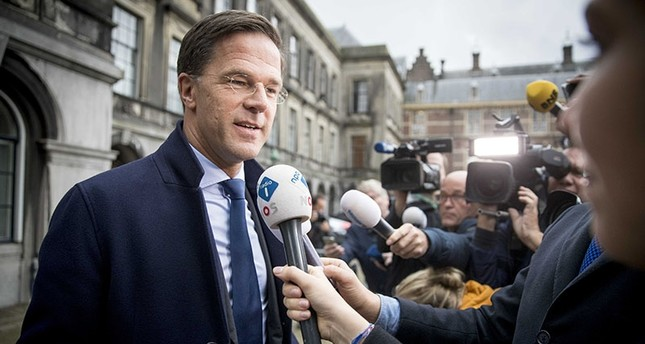 Mark Rutte of the The People's Party for Freedom and Democracy VVD party talks to the press at the Binnenhof, The Hague, The Netherlands, Oct. 09, 2017. EPA Photo